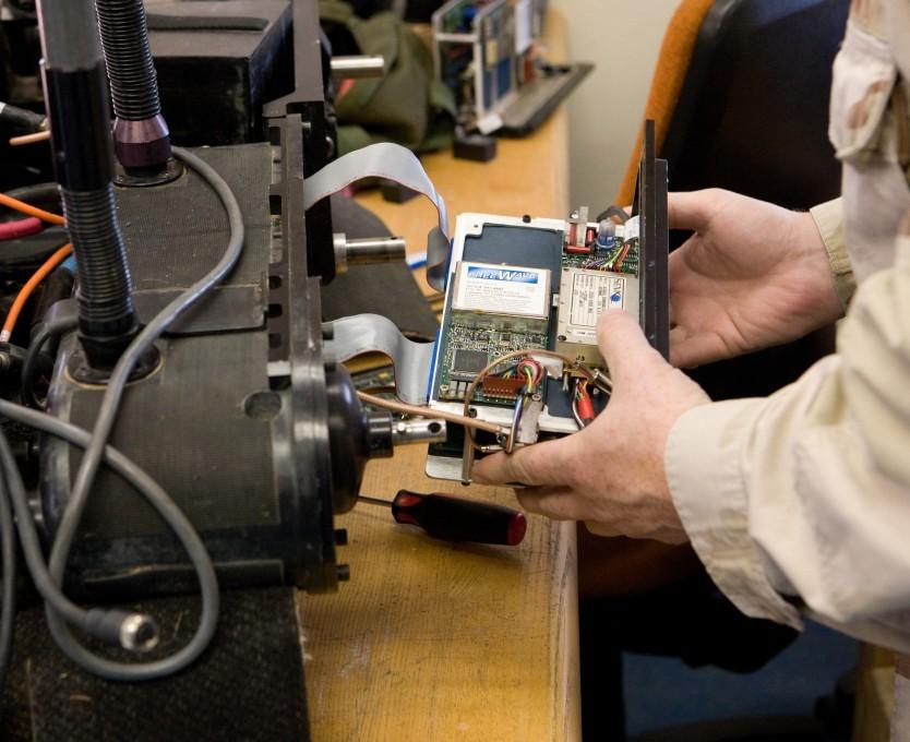 Technician-Working-on-Foster-Miller-Robot-s-RF-Module-eecue_31825_ej87_l